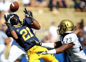 Keenan Allen (21) goes up for the ball against Jalil Brown (23) during a game against the University of Colorado.